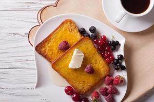 french toast with berries and coffee close-up. horizontal top vi