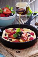 Pancake with berries fluffy and colorful