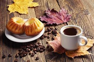 Coffee, cupcake and autumn leaves photo
