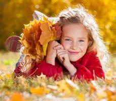 Girl at autumn photo