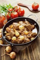 Stewed beef with onions and tomatoes, stifado photo
