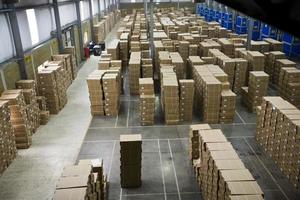 Warehouse with stacks of boxes photo