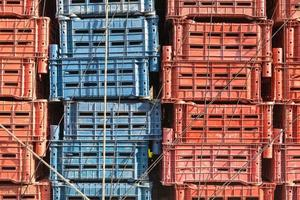 Empty plastic cargo boxes are stacked photo
