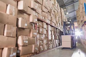 Forklift machine in warehouse photo
