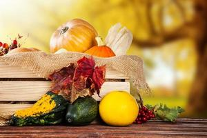 Autumn colored pumpkins in wooden box photo