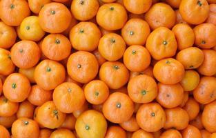 Crate of ripe tangerines.