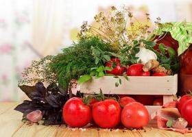 Tomatoes and herbs in crate