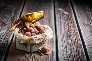 Chocolate balls in white box