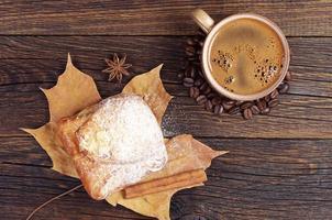 Coffee cup and sweet bun photo