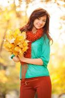 Young pretty woman walking in the autumn park photo