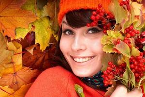 Young woman with autumn leaves.