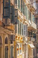 Window shutters on venetian style architecture, Greece