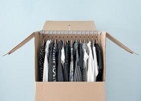 Clothes in a wardrobe box for easy moving photo