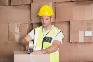 Worker preparing goods for dispatch photo