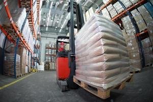 Driver using a forklift in a warehouse photo