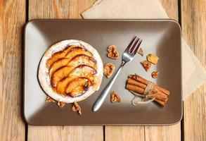 Homemade apple pie on a wooden background photo