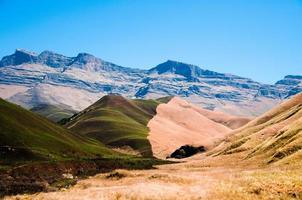 Half green, half brown grass fields in South Africa photo