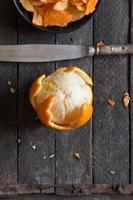 orange on old wooden table