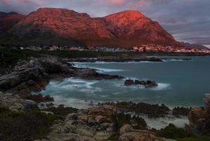 Hermanus seafront with mountains in soft eveningg light. photo