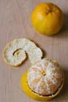 tangerine mandarin fruit on wooden background