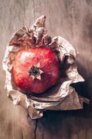 Pomegranates on a wooden background photo