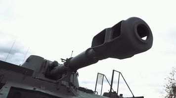 Muzzle brake compensator of tank gun on background of sky