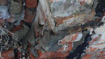 Destroyed red brick wall. video