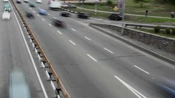 Panoramic timelapse passing city traffic cars bridge, daytime