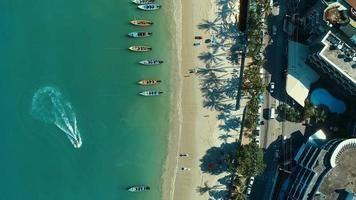 Aerial: Long tail boats and palms on the Patong beach. video