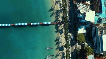 Aerial: Palms and long tail boats on the Patong beach. video