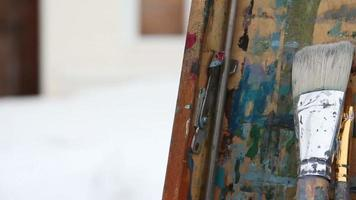 Paintbrushes at the easel. Panoramic shot video