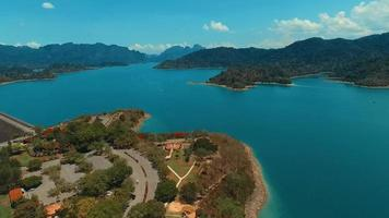 Aerial: Drone flies high above the lake. Panorama.