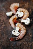 Peeled big size shrimps with mushroom photo