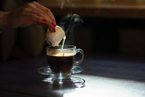 coffee with cream on table photo