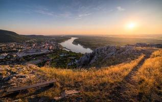 Small City with River from the Hill at Sunset photo