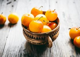 Fresh yellow plums in pottery, rustic, farmers