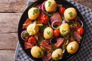 Rustic food: new potatoes with bacon Horizontal top view