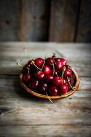 Sweet cherries on rustic wooden background