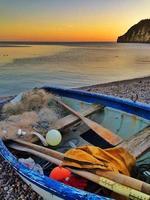 Small fishing boat on a Devon beach photo