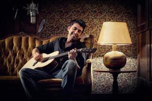 alternative singer plays guitar photo
