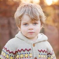 Portrait of beautiful little boy of 2 , outdoors