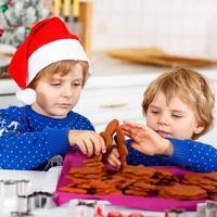 two little kid boys baking gingerbread cookies