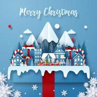 postal navideña cortada en papel con elementos de invierno