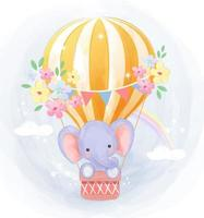 Cute little elephant flying in hot air balloon