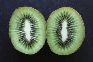 Cut kiwi on slate background