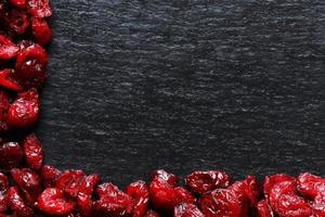Cranberries on slate background
