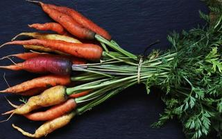 A bunch of colorful carrots