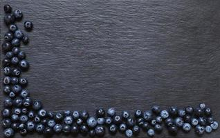 Blueberries on slate background