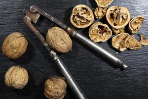 Nutcracker and walnuts on a slate background