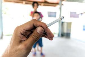 Cigarette in hand photo